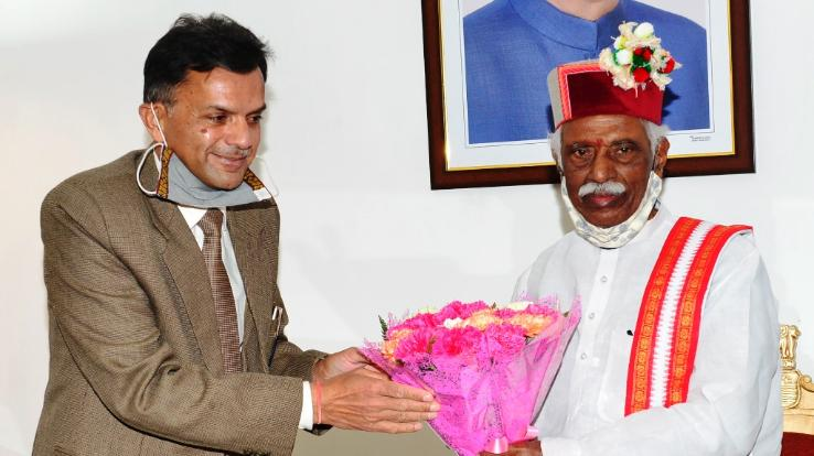 Chairman and member of Public Service Commission meet Governor