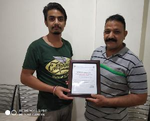 Jwalamukhi shopkeeper Rishi Raj Thakur honored with cleanliness award