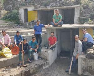 Villagers of Kund village clean water sources and roads