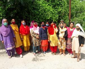 Women cleaning water resources in Hatkot Panchayat